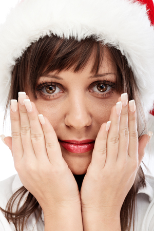 chins: Young woman with Santa hat close up with hands on chins Stock Photo