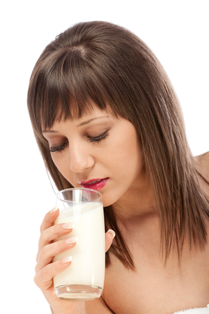 woman drinking milk: Woman drinking milk looking at camera, isolated on white background with copy space Stock Photo