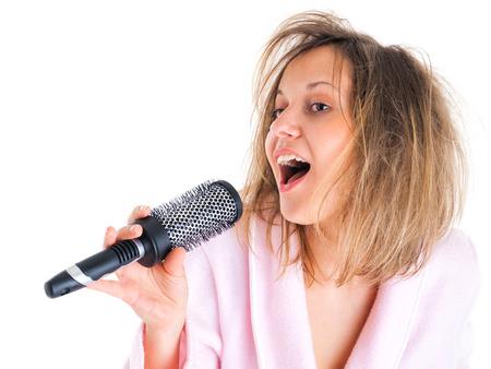 hairbrush: Woman singing with hairbrush