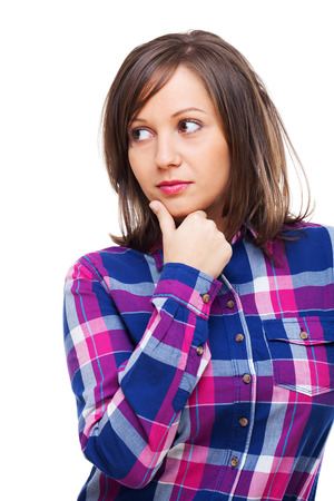 expressing: Young woman looking away expressing suspicion isolated on white background, close up Stock Photo