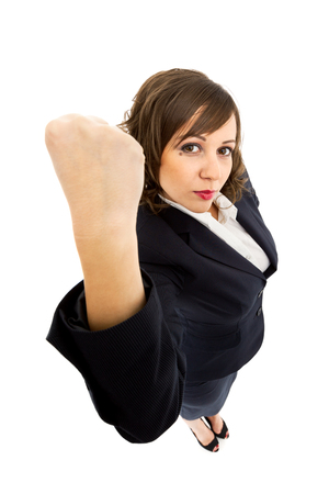 ''wide angle'': Businesswoman punching the air with angerisolated on white background shot with wide angle lenses