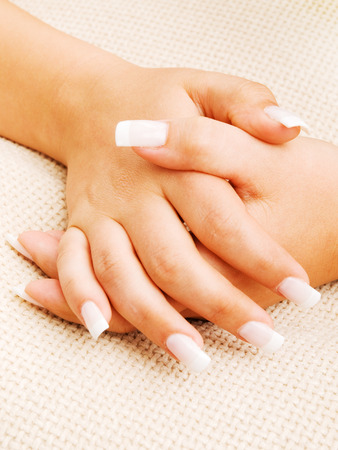 french manicure: Young womans french manicure, close up
