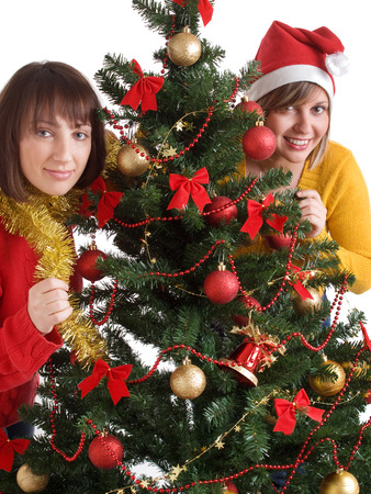wideangle: Young women with Christmas tree