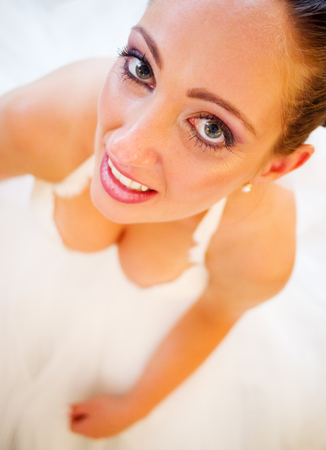 wideangle: Bride in a wedding dress sitting on the floor Stock Photo