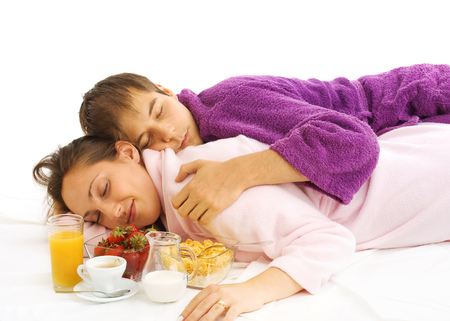 housecoat: Young couple in bed with breakfast