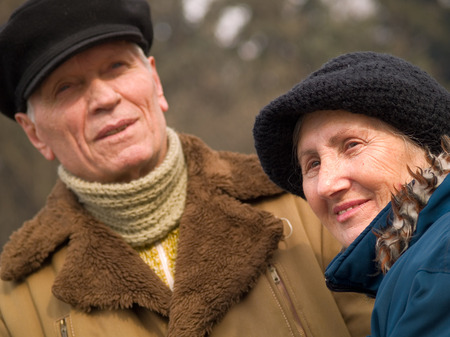 70s adult: 70-year-old couple in the park Stock Photo