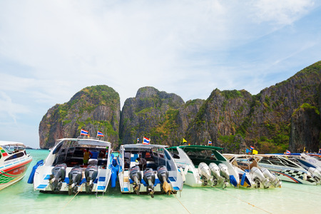 speedboats: Maya Bay, Thailand - March 15, 2011 : Speedboats waiting to take away the tourists from Maya Bay main beach