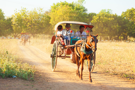 horse cart: Bagan, Myanmar - February 25, 2011 : Tourists enjoying a ride with horse cart for sightseeing in the morning