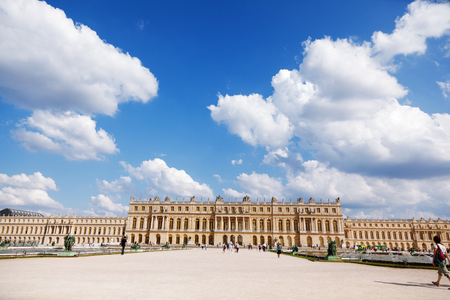 ange: Paris, France - September 03, 2011 : Wide ange view of Chateau of Versailles, the Royal Residence with tourists taking pictures and heading forward to visit it