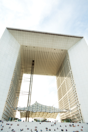 la defense: Paris, France - September 02, 2011 - People sitting on the stairs of Grande Arche in La Defense on Friday afternoon