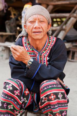 historical clothing: Chian Mai, Thailand - March 07, 2011: Street portrait of Thai man smoking