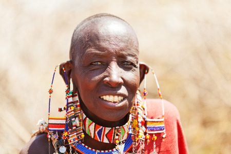 adult kenya: Amboseli, Kenya - February 07, 2012 : Portrait of an old masai man with traditional earings and necklaces welcoming visitors to the masai village in Amboseli national park