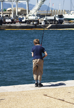 riviera: A boy fishing in the french riviera Editorial