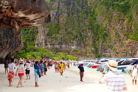holiday movies: Maya Bay, Thailand - March 15, 2011 : Tourists relaxing in the waters of Maya Bay where the movie The Beach has been shot in the morning. Editorial
