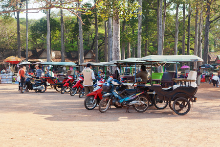tuktuk: Angkor Wat, Cambodia - March 19, 2011 : Cambodian tuk-tuk drivers waiting for tourists for a ride across the temples of ancient Angkor