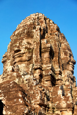 angkor thom: Stone carved face of Bayon Temple in Angkor Thom, Angkor district, Siem Reap, Cambodia. Close up Stock Photo