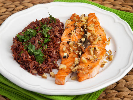 side dish: Baked salmon with brown wild rise side dish. Horizontal shot