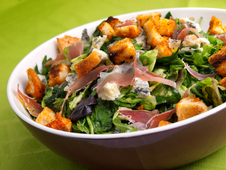 tilted view: French Provencal Salad with green salad, bacon, croutons and blue cheese. Tilted view. Stock Photo