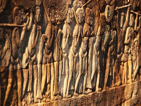 stone carvings: Stone carvings in Angkor wat, Cambodia. Shot at sunset Stock Photo