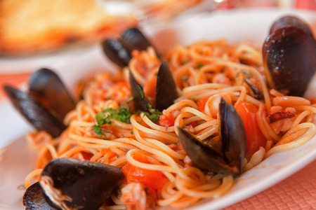 tilted view: Spaghetti with seafood. Close up, tilted view