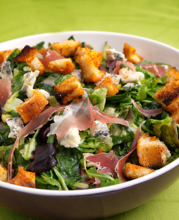 provencal: French Provencal Salad with green salad, bacon, croutons and blue cheese. Close up, vertical shot Stock Photo