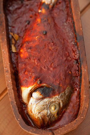 roof tile: Bream fish baked in roof tile with tomato sauce.