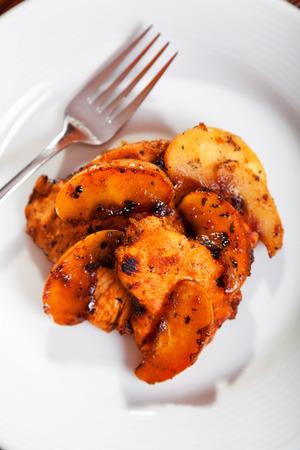 caramelized: Turkey fillet with slices caramelized apple. Shot from above. Vertical shot