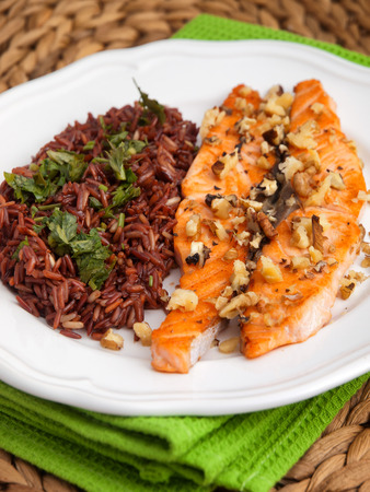 side dish: Baked salmon with brown wild rise side dish. Vertical shot Stock Photo