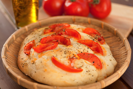 focaccia: Focaccia with tomatoes and olive oil, homemade, horizontal shot