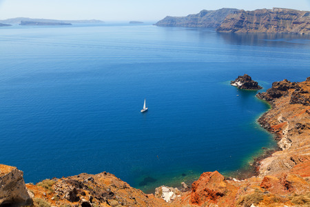 blue waters: A perfect view of the volcano in Oia, Santorini with blue waters of the sea Stock Photo