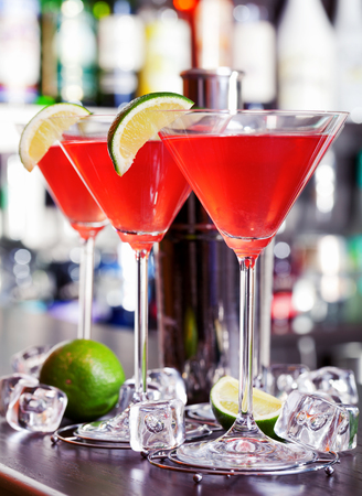 martini shaker: Cosmopolitan cocktails shot on a bar counter in a nightclub. Full length Stock Photo