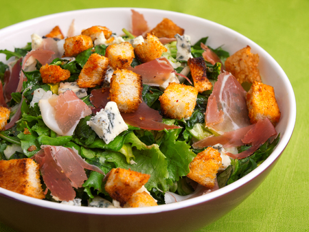 French Provencal Salad with green salad, bacon, croutons and blue cheese. Close up, horizontal shot