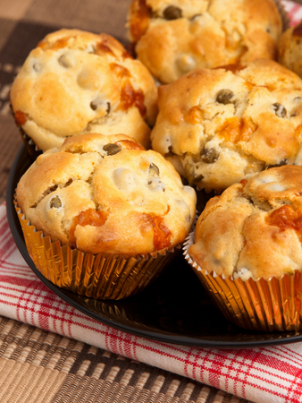 and savory: Savory muffins with ham, cheese dried tomatoes, vertical shot