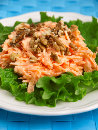 fres: Coleslaw salad with walnuts over fres lettuce. Vertical shot