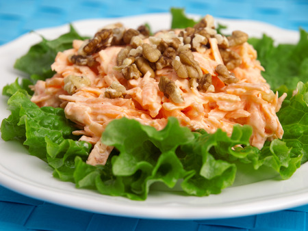 fres: Coleslaw salad with walnuts over fres lettuce. Horizontal shot