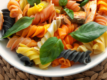 fusilli: Colorful fusilli pasta with baked salmon and basil. Horizontal shot