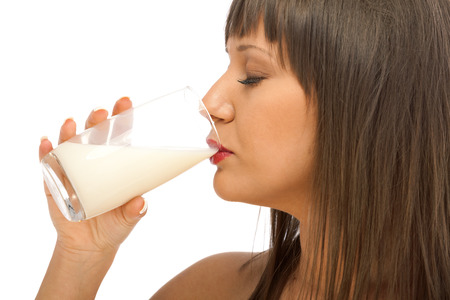 woman drinking milk: Young woman drinking milk. Side view, isolated on white background