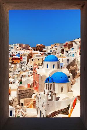 oia: Famous churches of Oia, Santorini. Framed view. Vertical shot. Stock Photo