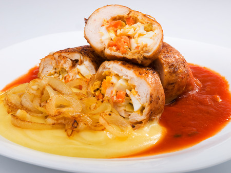 potatoe: Chicken roulades stuffed with boiled eggs, carrots and onion. Tomato and potatoe puree for side dish