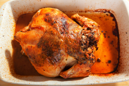 whole chicken: Baked whole chicken with herbs. Horizontal shot