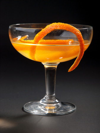 sweet vermouth: Satan Whiskers cocktail isolated on black background. Made from 1 oz gin, 12 oz orange liqueur, 1 oz dry vermouth, 1 oz sweet vermouth, 1 oz orange juice, 2 dashes orange bitters Stock Photo
