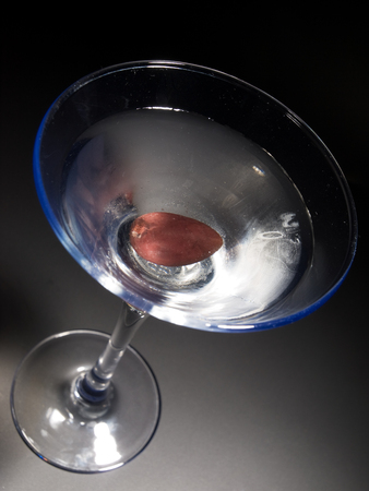 tilted: Martini cocktail isolated on black background. Tilted Stock Photo