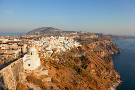 fira: Cityscape panorama of Fira town, Santorini in the late afternoon