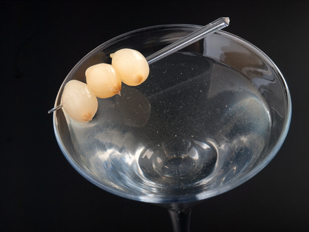 gibson: Cocktail Gibson with onions isolated on black background. Horizontal shot Stock Photo