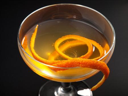 Satan Whiskers cocktail isolated on black background. Made from 1 oz gin, 12 oz orange liqueur, 1 oz dry vermouth, 1 oz sweet vermouth, 1 oz orange juice, 2 dashes orange bitters Stock Photo