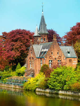 bruges: Canal in Bruges with ancient building and trees Stock Photo