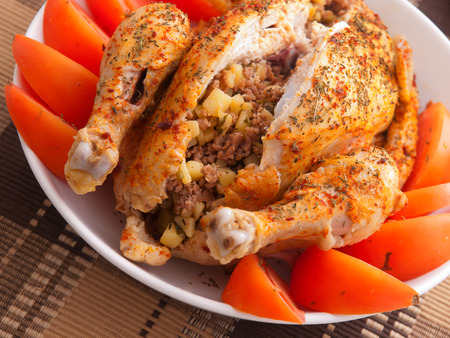 whole chicken: Baked whole chicken stuffed with potatoes and minced meat
