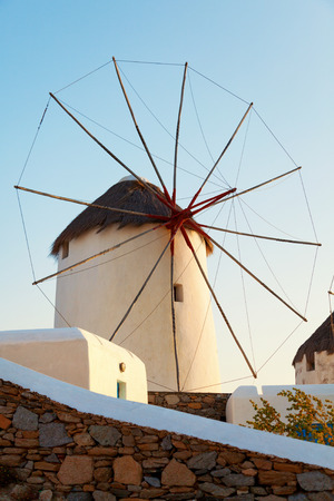 mykonos: Windmill in front of a blue sky in Mykonos island, Greece at sunset. Vertical shot. Stock Photo