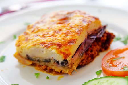 Greek style moussaka with eggplants, ground beef and potatoes. Horizontal shot