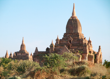 Ancient pagodas in Bagan, blue sky in background